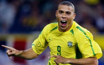 RR039 - 20020626 - SAITAMA, JAPAN : Brazil's forward Ronaldo celebrates after scoring the first goal against Turkey during the semi-final match of the FIFA 2002 World Cup Korea Japan 26 June, 2002, in Saitama, Japan.  EPA PHOTO AFPI/PATRICK HERTZOG/stf