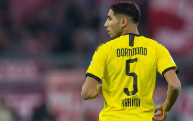 MUNICH, GERMANY - NOVEMBER 09: Achraf Hakimi of Borussia Dortmund looks on during the Bundesliga match between FC Bayern Muenchen and Borussia Dortmund at Allianz Arena on November 9, 2019 in Munich, Germany. (Photo by TF-Images/Getty Images)