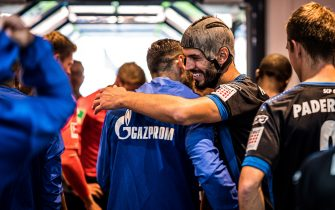 PADERBORN, GERMANY - SEPTEMBER 15: (EDITORS NOTE: Image has been digitally enhanced.) Klaus Gjasula (R) of Paderborn greets players of Schalke in the tunnel prior to the Bundesliga match between SC Paderborn 07 and FC Schalke 04 at Benteler Arena on September 15, 2019 in Paderborn, Germany. (Photo by Lukas Schulze/Bundesliga/Bundesliga Collection via Getty Images)