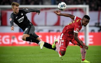 epaselect epa07982243 Hoffenheim's Stefan Posch (L) in action against Cologne's Jhon Cordoba (R) during the German Bundesliga soccer match between 1. FC Koeln and TSG 1899 Hoffenheim in Cologne, Germany, 08 November 2019.  EPA/SASCHA STEINBACH CONDITIONS - ATTENTION: The DFL regulations prohibit any use of photographs as image sequences and/or quasi-video.