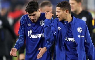epa07899349 Schalke's Suat Serdar (L) and Schalke's Amine Harit react after the German Bundesliga soccer match between FC Schalke 04 and FC Koeln in Gelsenkirchen, Germany, 05 October 2019.  EPA/FRIEDEMANN VOGEL CONDITIONS - ATTENTION: The DFL regulations prohibit any use of photographs as image sequences and/or quasi-video.