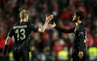 Frankfurt's Portuguese forward Goncalo Paciencia (R) celebrates his goal with Frankfurt's German defender Martin Hinteregger during the UEFA Europa league quarter final first leg football match between SL Benfica and Eintracht Frankfurt at the Luz stadium in Lisbon on April 11, 2019. (Photo by CARLOS COSTA / AFP)        (Photo credit should read CARLOS COSTA/AFP via Getty Images)