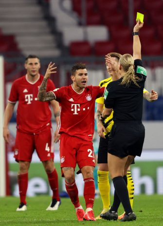 MUNICH, GERMANY - SEPTEMBER 30: Lucas Hernandez of Bayern Munich reacts as he is shown a yellow card by referee Referee Bibiana Steinhaus during the Supercup 2020 match between FC Bayern Muenchen and Borussia Dortmund at Allianz Arena on September 30, 2020 in Munich, Germany.  (Photo by Alexander Hassenstein/Getty Images )