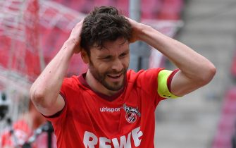 epa09220131 Cologne's Jonas Hector reacts during the German Bundesliga soccer match between FC Koeln and FC Schalke 04 in Cologne, Germany, 22 May 2021.  EPA/SASCHA STEINBACH / POOL CONDITIONS - ATTENTION: The DFL regulations prohibit any use of photographs as image sequences and/or quasi-video.