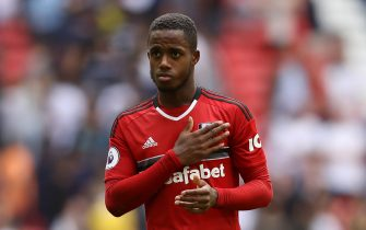 LONDON, ENGLAND - AUGUST 18:  Ryan Sessegnon of Fulham holds his team badge following the Premier League match between Tottenham Hotspur and Fulham FC at Wembley Stadium on August 18, 2018 in London, United Kingdom.  (Photo by Dan Istitene/Getty Images)