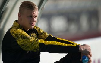 Borussia Dortmund's Norwegian forward Erling Braut Haland sits on the bench during the friendly football match between Standard Liege and Borussia Dortmund at the Antonio Lorenzo Cuevas municipal stadium in Marbella on January 7, 2020. (Photo by JORGE GUERRERO / AFP) / The erroneous mention[s] appearing in the metadata of this photo by JORGE GUERRERO has been modified in AFP systems in the following manner: [Norwegian] instead of [British]. Please immediately remove the erroneous mention[s] from all your online services and delete it (them) from your servers. If you have been authorized by AFP to distribute it (them) to third parties, please ensure that the same actions are carried out by them. Failure to promptly comply with these instructions will entail liability on your part for any continued or post notification usage. Therefore we thank you very much for all your attention and prompt action. We are sorry for the inconvenience this notification may cause and remain at your disposal for any further information you may require. (Photo by JORGE GUERRERO/AFP via Getty Images)
