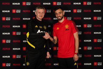 MANCHESTER, ENGLAND - JANUARY 30: (EXCLUSIVE COVERAGE) Bruno Fernandes of Manchester United poses with Manager Ole Gunnar Solskjaer after signing for the club at Aon Training Complex on January 30, 2020 in Manchester, England. (Photo by Manchester United/Manchester United via Getty Images)