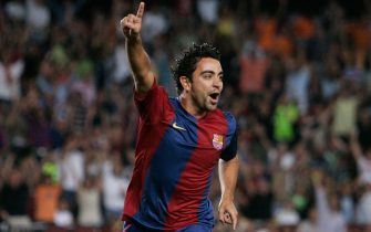 BARCELONA, SPAIN - AUGUST 20:  Xavi of Barcelona celebrates after scoring his team's first goal against Espanyol during a Supercup, 2nd leg, match at the Camp Nou stadium on August 20, 2006 in Barcelona, Spain. (Photo by Denis Doyle/Getty Images)
