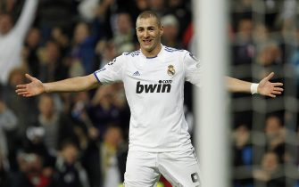 MADRID, SPAIN - DECEMBER 08: Karim Benzema of Real Madrid celebrates after scoring Real's third goal during the Champions League group G match between Real Madrid and AJ Auxerre at Estadio Santiago Bernabeu on December 8, 2010 in Madrid, Spain. (Photo by Angel Martinez/Getty Images)
