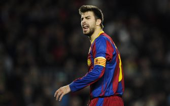 BARCELONA, SPAIN - DECEMBER 07:  Gerard Pique of Barcelona reacts during the Champions League match between Barcelona and Rubin Kazan at Camp Nou Stadium on December 7, 2010 in Barcelona, Spain.  Barcelona won 2-0.  (Photo by David Ramos/Getty Images)