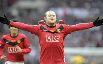 Manchester United's English striker Wayne Rooney celebrates after scoring his team's second goal against Aston Villa during the 2010 Carling Cup Final at Wembley, in north London, on February 28, 2010. AFP PHOTO/CARL DE SOUZA (Photo credit should read CARL DE SOUZA/AFP via Getty Images)