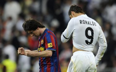 Barcelona's Argentinian forward Lionel Messi (L) celebrates after scoring next to Real Madrid's Portuguese forward Cristiano Ronaldo during the 'El Clasico' Spanish League football match Real Madrid against Barcelona at the Santiago Bernabeu stadium in Madrid, on April 10, 2010. AFP PHOTO/Dani POZO . (Photo credit should read Dani Pozo/AFP via Getty Images)