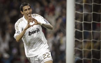 epa03171393 Real Madrid's Argentinian striker Angel di Maria jubilates his goal against Apoel Nicosia during their Champions League quarter final second leg match played at Santiago Bernabeu in Madrid, Spain, 04 March 2012.  EPA/EMILIO NARANJO