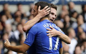 epa03440122 Chelsea's Juan Mata (back) celebrates with his teammate Eden Hazard (front) after scoring against Tottenham Hotspur during their English Premier League soccer match at White Hart Lane in London, Britain, 20 October 2012. Chelsea won 4-2.  EPA/ANDY RAIN DataCo terms and conditions apply. http//www.epa.eu/downloads/DataCo-TCs.pdf