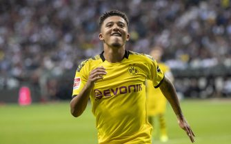 FRANKFURT AM MAIN, GERMANY - SEPTEMBER 22: Jadon Sancho of Borussia Dortmund celebrates after scoring his team's second goal during the Bundesliga match between Eintracht Frankfurt and Borussia Dortmund at Commerzbank-Arena on September 22, 2019 in Frankfurt am Main, Germany. (Photo by TF-Images/Getty Images)