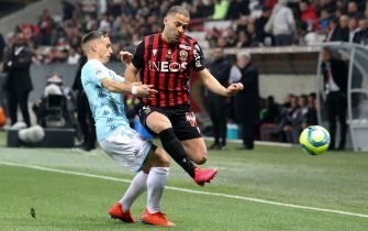 Nice's Danish defender Riza Durmisi (R) vies with Monaco's French defender Ruben Aguilar during the French L1 football match between Nice and Monaco on March 7, 2020 at the Allianz Riviera stadium in Nice, southeastern France. (Photo by VALERY HACHE / AFP) (Photo by VALERY HACHE/AFP via Getty Images)