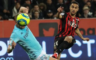 Nice's French midfielder Adam Ounas (R) fights for the ball with Monaco's Polish defender Kamil Glik (L) during the French L1 football match Nice against Monaco on March 07, 2020 at the Allianz Riviera stadium in Nice, southeastern France. (Photo by VALERY HACHE / AFP) (Photo by VALERY HACHE/AFP via Getty Images)