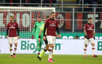 epa08173725 Milan's Zlatan Ibrahimovic (C) shows his dejection after Torino's Bremer (not seen) scored his second goal during the Italy Cup quarter final soccer match AC Milan vs Torino FC at the Giuseppe Meazza stadium in Milan, Italy, 28 January 2020.  EPA/MATTEO BAZZI