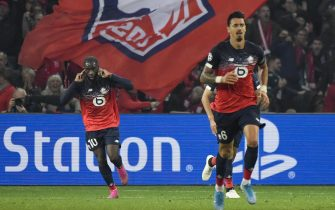 epa07944461 Lille's Jonathan Ikone (L) celebrates after scoring during the UEFA Champions League soccer Group H match between OSC Lille and Valencia CF at the Pierre Mauroy Stadium in Villeneuve-d'Ascq, near Lille, France, 23 October 2019.  EPA/JULIEN DE ROSA