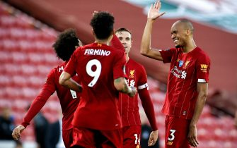 epa08507273 Liverpool's Fabinho (R) celebrates with his teammates after scoring the 3-0 lead during the English Premier League match between Liverpool FC and Crystal Palace in Liverpool, Britain, 24 June 2020.  EPA/Phil Noble/NMC/Pool EDITORIAL USE ONLY. No use with unauthorized audio, video, data, fixture lists, club/league logos or 'live' services. Online in-match use limited to 120 images, no video emulation. No use in betting, games or single club/league/player publications.