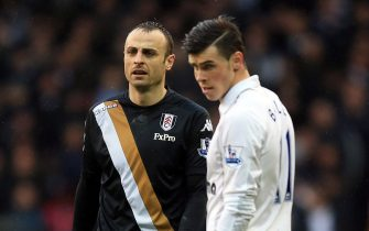 LONDON, ENGLAND - MARCH 17:  Dimitar Berbatov of Fulham and Gareth Bale of Tottenham in action during the Barclay's Premier League match between Tottenham Hotspur and Fulham at White Hart Lane on March 17, 2013 in London, England.  (Photo by Richard Heathcote/Getty Images)