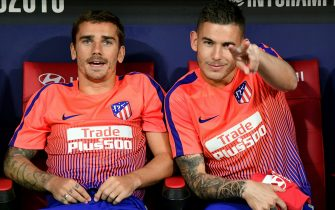 Atletico Madrid's French defender Lucas Hernandez (R) gestures next to Atletico Madrid's French forward Antoine Griezmann during the International Champions Cup football match Club Atletico de Madrid vs Inter Milan at the Wanda Metropolitano stadium in Madrid on August 11, 2018. (Photo by JAVIER SORIANO / AFP)        (Photo credit should read JAVIER SORIANO/AFP via Getty Images)