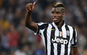 TURIN, ITALY - SEPTEMBER 16:  Paul Pogba of Juventus salutes the fans at the end of the UEFA Champions League Group A match between Juventus and Malmo FF on September 16, 2014 in Turin, Italy.  (Photo by Valerio Pennicino/Getty Images)
