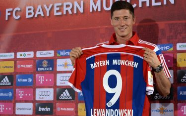 Bayern Munich's new Polish striker Robert Lewandowski holds his new trikot of the German first division Bundesliga team FC Bayern Munich during a news conference in Munich, southern Germany, on July 9, 2014. AFP PHOTO/CHRISTOF STACHE        (Photo credit should read CHRISTOF STACHE/AFP via Getty Images)