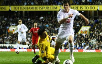 LONDON - SEPTEMBER 26: Gareth Bale of Tottenham rounds Brad Jones of Middlesbrough to score the opening goal for Tottenham during the Carling Cup third round match between Tottenham Hotspur and Middlesbrough at White Hart Lane on September 26, 2007 in London, England.  (Photo by Clive Rose/Getty Images)