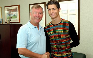 MANCHESTER, ENGLAND - AUGUST 12:  Sir Alex Ferguson greets Cristiano Ronaldo as the young Portugese player signs for Manchester united at the Carrington Training Ground, Carrington on August 12, 2003 in Manchester, England.  (Photo by John Peters/Manchester United via Getty Images)