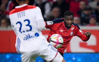 LILLE, FRANCE - DECEMBER 1: (L-R) Kenny Tete of Olympique Lyon, Fode Ballo Toure of Lille  during the French League 1  match between Lille v Olympique Lyon at the Stade Pierre Mauroy on December 1, 2018 in Lille France (Photo by Angelo Blankespoor/Soccrates/Getty Images)