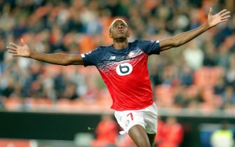 epa07975053 Lille's Victor Osimhen celebrates after scoring the 1-0 lead during a UEFA Champions League soccer group stage match between Valencia CF and OSC Lille at Mestalla stadium on 05 November 2019.  EPA/Kai Foersterling