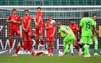 epa08512294 Maximilian Arnold of Wolfsburg takes a free kick during the Bundesliga match between VfL Wolfsburg and FC Bayern Munich at Volkswagen Arena on June 27, 2020 in Wolfsburg, Germany.  EPA/Stuart Franklin / POOL DFL regulations prohibit any use of photographs as image sequences and/or quasi-video.