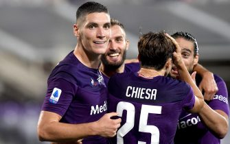 Fiorentina's defender Nikola Milenkovic (L) celebrates after scoring during the Italian Serie A soccer match between ACF Fiorentina and Bologna FC at the Artemio Franchi stadium in Florence, Italy, 29 July 2020ANSA/CLAUDIO GIOVANNINI