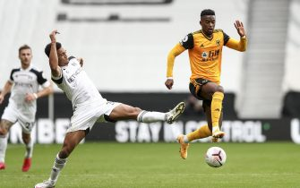epa08719914 Antonee Robinson of Fulham (L) and Nelson Semedo of Wolverhampton Wanderers (R) in action during the English Premier League match between Wolverhampton Wanderers and Fulham in Wolverhampton, Britain, 04 October 2020.  EPA/Jan Kruger / POOL EDITORIAL USE ONLY. No use with unauthorized audio, video, data, fixture lists, club/league logos or 'live' services. Online in-match use limited to 120 images, no video emulation. No use in betting, games or single club/league/player publications.
