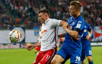 LEIPZIG, GERMANY - SEPTEMBER 11:  Nils Quaschner (L) of Leipzig is challenged by Hauke Wahl of Paderborn during the Second Bundesliga match between RB Leipzig and SC Paderborn at Red Bull Arena on September 11, 2015 in Leipzig, Germany.  (Photo by Boris Streubel/Bongarts/Getty Images)