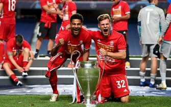LISBON, PORTUGAL - AUGUST 23: Serge Gnabry and Joshua Kimmich of FC Bayern Munich celebrate with the UEFA Champions League Trophy following their team's victory in the UEFA Champions League Final match between Paris Saint-Germain and Bayern Munich at Estadio do Sport Lisboa e Benfica on August 23, 2020 in Lisbon, Portugal. (Photo by Michael Regan - UEFA/UEFA via Sipa Press - Handout Photo Editorial Use only )//04SIPA_1706.3401/2008241111/Credit:Michael Regan - UEFA/SIPA/2008241116