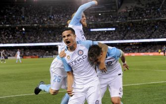 epa05587143 Tim Cahill of City FC celebrates with team-mate Bruno Fornaroli of City FC after scoring a goal, during the round 2 A-League match between Melbourne Victory and Melbourne City, played at Etihad stadium in Melbourne, Australia, 15 October 2016. Cahill made his debut appearance in the Melbourne darby.  EPA/JOE CASTRO AUSTRALIA AND NEW ZEALAND OUT