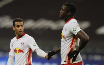 epa08834590 Leipzig players Tyler Adams (L) and Ibrahima Konate (R) react after the German Bundesliga soccer match between SG Eintracht Frankfurt and RB Leipzig in Frankfurt, Germany, 21 November 2020.  EPA/RONNY WITTEK / POOL CONDITIONS - ATTENTION: The DFL regulations prohibit any use of photographs as image sequences and/or quasi-video.
