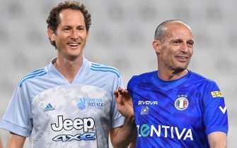 """Former Juventus' coach Massimiliano Allegri (R)and  Exor chairman and Ceo John Elkann  during the 30th 'match of the heart' 2021 charity football match between the """"Nazionale Cantanti"""" (Singers national team) and """"Campioni per la Ricerca"""" (Research champions)at the Allianz Stadium in Turin, Italy, 25 May 2021 ANSA/ALESSANDRO DI MARCO"""
