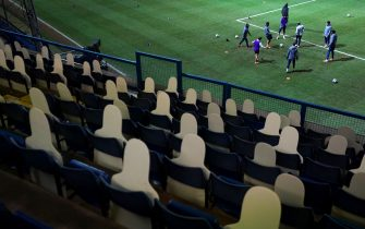 General view of the Luton Town players warming up inside an empty stand prior to kick-off during the Sky Bet Championship match at Kenilworth Road, Luton. Picture date: Tuesday February 16, 2021.