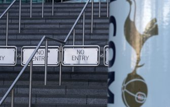 A view of a 'No Entry' barrier at Tottenham Hotspur Stadium in London where Tottenham's Premier League match against Fulham this evening has been postponed due to a coronavirus outbreak at the west London club, Spurs have announced.
