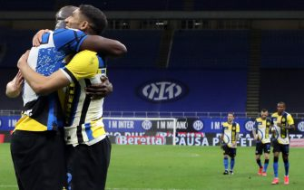 Inter Milan's Romelu Lukaku (L) jubilates with his teammate Achraf Hakimi after scoring goal of 3 to 1   during the Italian serie A soccer match between FC Inter  and As Roma at Giuseppe Meazza stadium in Milan, 12 May 2021.ANSA / MATTEO BAZZI