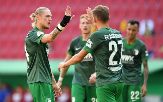 AUGSBURG, GERMANY - SEPTEMBER 12: Fredrik Jensen of Augsburg celebrates with Alfred Finnbogason of Augsburg after scoring his team's sixth goal during the DFB Cup first round match between MTV Eintracht Celle and FC Augsburg at WWK-Arena on September 12, 2020 in Augsburg, Germany. (Photo by Sebastian Widmann/Getty Images)