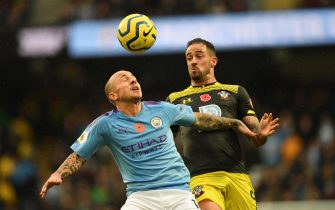 epa07967193 Manchester City's Angelino (L) vies for the ball against Southampton's Danny Ings (R)  during the English Premier League soccer match between Manchester City v Southampton at the Etihad stadium in Manchester, Britain, 02 November 2019.  EPA/FACUNDO ARRIZABALAGA EDITORIAL USE ONLY. No use with unauthorized audio, video, data, fixture lists, club/league logos or 'live' services. Online in-match use limited to 120 images, no video emulation. No use in betting, games or single club/league/player publications