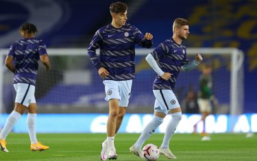 Chelsea's German midfielder Kai Havertz (C) and Chelsea's German striker Timo Werner (R) warm up ahead of the English Premier League football match between Brighton and Hove Albion and Chelsea at the American Express Community Stadium in Brighton, southern England on September 14, 2020. (Photo by Richard Heathcote / POOL / AFP) / RESTRICTED TO EDITORIAL USE. No use with unauthorized audio, video, data, fixture lists, club/league logos or 'live' services. Online in-match use limited to 120 images. An additional 40 images may be used in extra time. No video emulation. Social media in-match use limited to 120 images. An additional 40 images may be used in extra time. No use in betting publications, games or single club/league/player publications. /  (Photo by RICHARD HEATHCOTE/POOL/AFP via Getty Images)