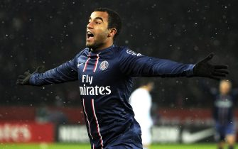 epa03598994 Lucas Moura of Paris Saint-Germain celebrates after scoring the opening goal during the French Ligue 1 soccer match between Paris Saint Germain and Olympique Marseille at Parc des Princes stadium in Paris, France, 24 February 2013.  EPA/YOAN VALAT