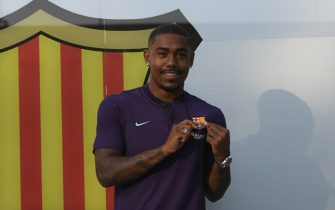 Barcelona's new Brazilian forward Malcom poses at the Camp Nou stadium in Barcelona on July 24, 2018. - Spanish champions Barcelona announced they have signed Brazilian winger Malcom from French side Bordeaux on a five-year deal for 41 million euros ($48 million). (Photo by LLUIS GENE / AFP)        (Photo credit should read LLUIS GENE/AFP/Getty Images)