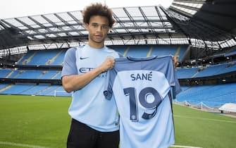Manchester City New Signing Leroy Sane, Etihad Stadium, Leroy Sane his new shirt   (Photo by Mark Robinson/Manchester City FC via Getty Images)