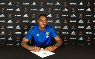 MANCHESTER, ENGLAND - JUNE 29: Aaron Wan-Bissaka of Manchester United poses after signing for the club at Aon Training Complex on June 29, 2019 in Manchester, England. (Photo by Manchester United/Manchester United via Getty Images)